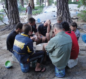 Guys playing Bid Euchre in wilderness